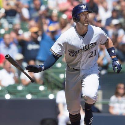 Travis Shaw watches his three-run home run, his 12th
