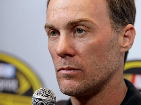 Driver Kevin Harvick listens to a question during the NASCAR Sprint Cup series auto racing Eliminator Media Day in Charlotte, N.C., Tuesday, Oct. 27, 2015.  (AP Photo/Chuck Burton)