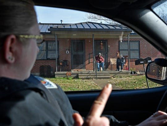 Springfield Police Corporal Martha Moore wave to residents as she does her patrol through public housing. Moore is staying in a job where gang members threaten violence against officers and crowds of residents responding to police calls trying to draw a reaction from officers Wednesday Nov. 22, 2017, in Springfield, TN