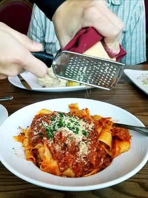 Tuttu Fresco's Pappardelle Bolognese was presented in a large bowl. The ribbons were smothered in a fragrant, meaty red sauce and sprinkled with freshly shaved Parmigiano-Reggiano.