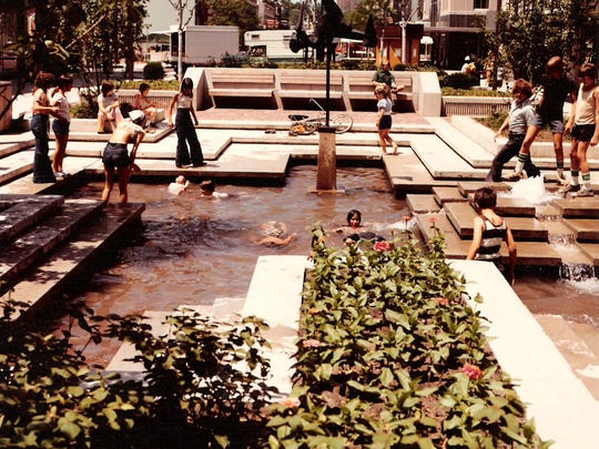 Kids play in the Michigan Mall fountain in downtown Battle Creek in this undated photo. Battle Creek city commissioners voted to remove the mall and reopen Michigan Avenue in 1992.