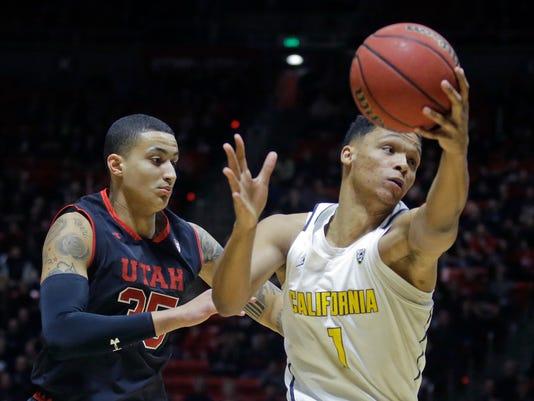 California forward Ivan Rabb (1) pulls down a rebound as Utah forward Kyle Kuzma, left, defends during the first half of an NCAA college basketball game Thursday, March 2, 2017, in Salt Lake City. (AP Photo/Rick Bowmer)