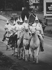 Klansmen ride toward Rising Sun, Md. in June 1972.
