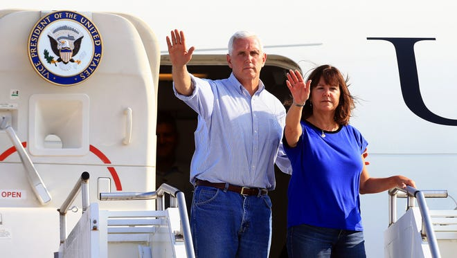 Vice President Mike Pence, left, and wife Karen Pence wave after visiting the Coastal Bend after Hurricane Harvey destroyed several homes Thursday, Aug. 31, 2017, in Corpus Christi, Texas.