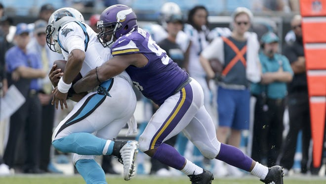 The Carolina Panthers' Cam Newton (1) can't get out of a sack by the Minnesota Vikings' Everson Griffen (97) during the Sept. 18 game in Charlotte, N.C.