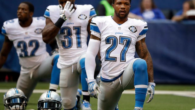 FILE - In this Sept. 11, 2016, file photo, Detroit Lions free safety Glover Quin (27) stretches before an NFL football game against the Indianapolis Colts in Indianapolis. The Lions have made a lot of moves over the years that simply haven't panned out. Signing Glover Quin as a free agent in 2013 has been an exception. Quin has started 105 straight games, the longest active streak by an NFL safety and the longest among the Lions. He had an NFL-high seven interceptions in 2014.  (AP Photo/Jeff Roberson, File) ORG XMIT: NY173