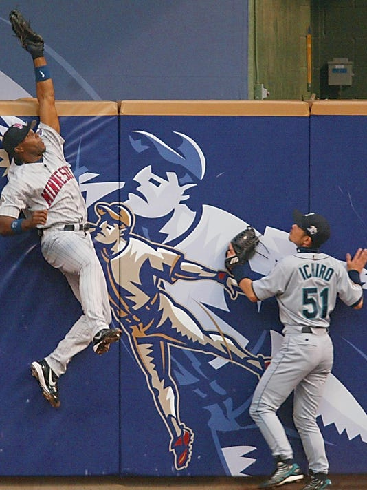 FILE: Torii Hunter (L) of the the American League