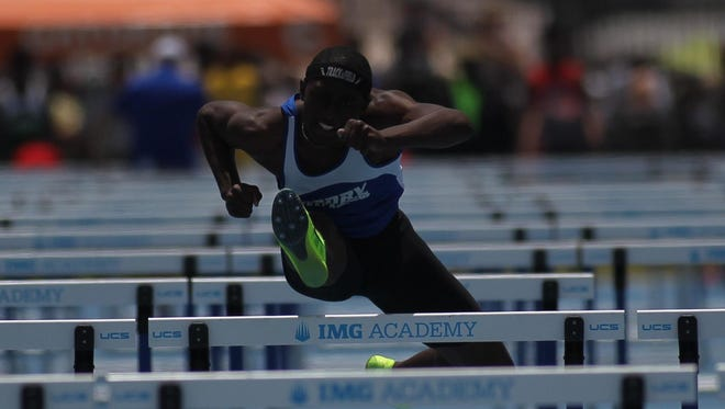 Godby senior Tyricke Dickens races to a gold medal in the 110-meter high hurdles.