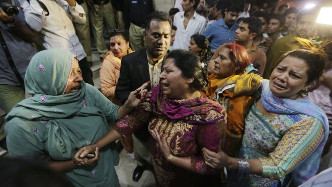 Relatives of the victims of a suicide bomb blast cry outside a hospital in Lahore, Pakistan.