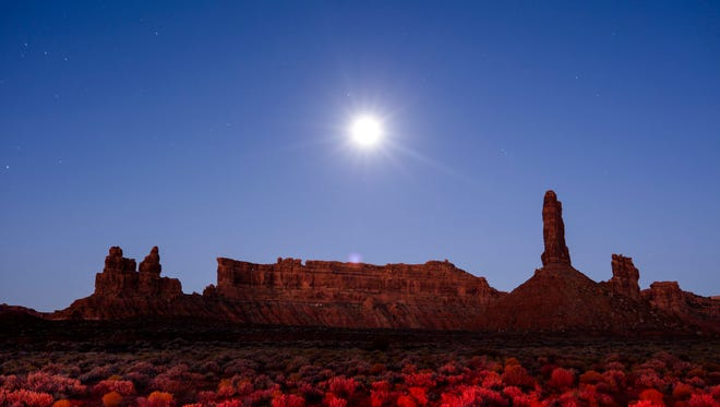 Sandstone formations rise from the Valley of the Gods under a full moon in the Bear Ears National Monument near Mexican Hat, Utah, Nov. 15, 2016.