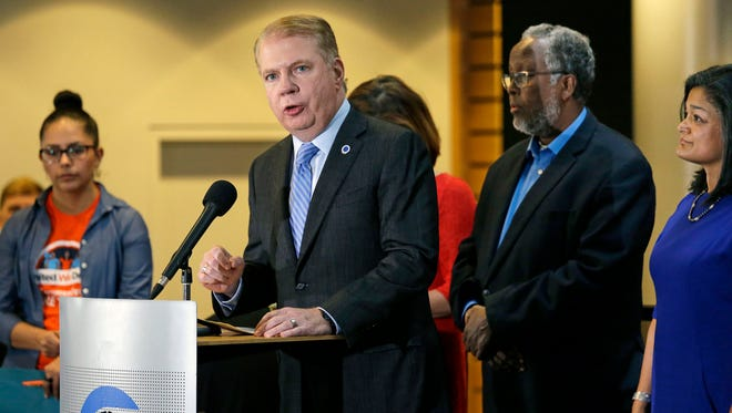 """Seattle Mayor Ed Murray, second from left, speaks at a post-election event of elected officials and community leaders at City Hall in Seattle. Leaders in Seattle, San Francisco and other so-called """"sanctuary cities"""" say they won't change their stance on immigration despite President Donald Trump's vows to withhold potentially millions of dollars in taxpayer money if they don't cooperate."""