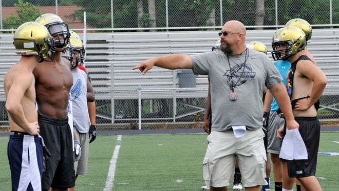 Roberson first-year football coach Chris Deal conducts practice on Friday.