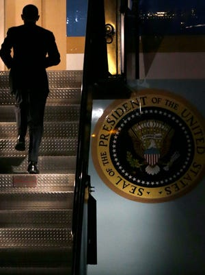 President Obama heads up a stairway to Air Force One at Logan International Airport after attending two fundraisers in Boston on March 5.