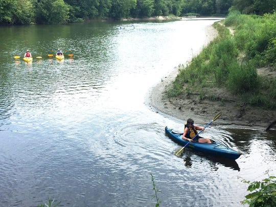 Kayakers prepare to return to dry land after a round trip Sunday between Burlington's Intervale and Winooski. Participants in the Winooski Pedal and Paddle bicycled the first, upstream leg of the fundraiser. Photographed July 23, 2017.