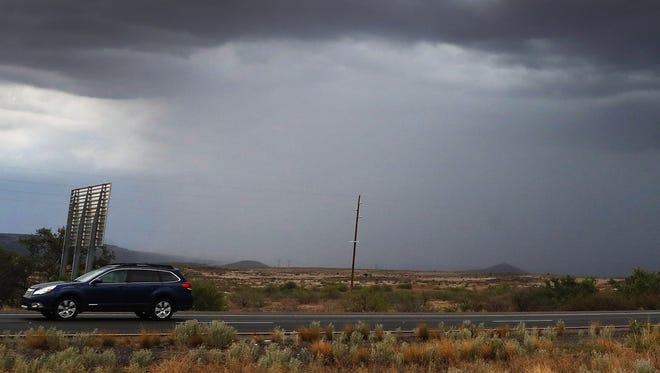 Rain falls east of Cordes Lakes, Arizona, on July 11, 2018.