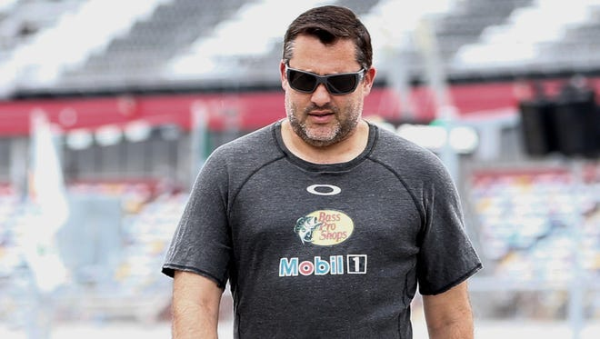 Tony Stewart won Sprint Cup titles in 2002, 2005 and 2011.