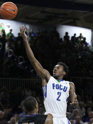 Bernard Thompson (2) attempts a basket in the second period of their game against UCSB at Alico Arena on November 17, 2014, in Fort Myers, Fla. This is the second game of the season, and first against a Division I team. (Dania Maxwell/Staff)