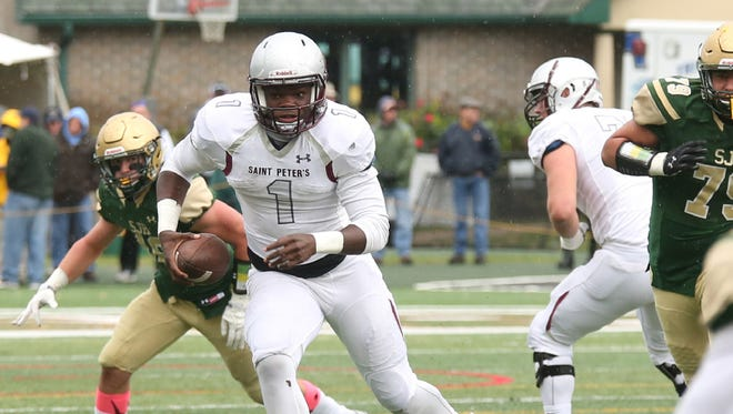 From 2016: St. Peter's Prep quarterback Jonathan Lewis looks for room against St. Joes. Lewis is now a freshman at Rutgers.