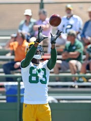 Packers rookie receiver Marquez Valdes-Scantling (83) catches a ball during minicamp on June 13.