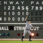 Yankees left fielder Brett Gardner catches a fly ball by Boston's Dustin Pedroia in the sixth inning of a baseball game at Fenway Park on Friday, April 29, 2016, in Boston.