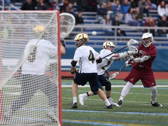 Arlington's Riley Carroll takes a shot on goal during