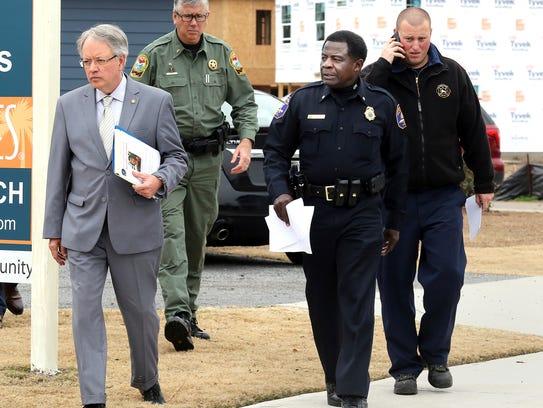 Charleston Mayor John Tecklenburg, left, and interim