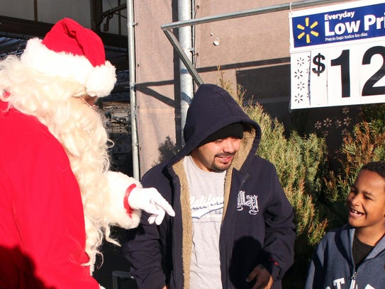 Santa Claus checks on Phillip Broner to make sure he