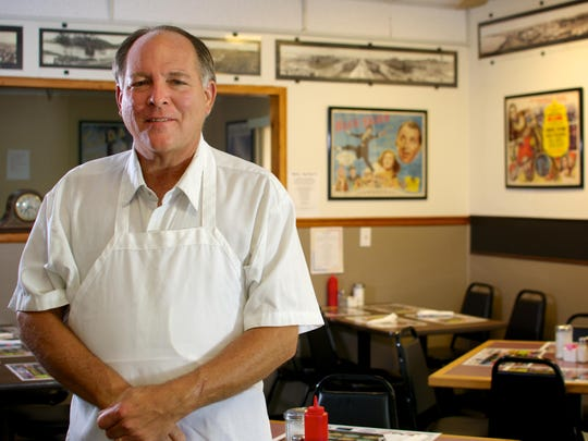 Owner/chef Raymond Macht has a collection of movie and Panama Canal memorabilia on the walls at 2002 Restaurant in Barefoot Bay.