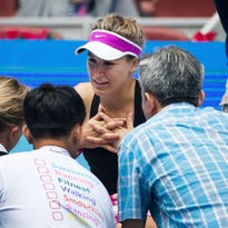 Eugenie Bouchard of Canada, center, talks with medical