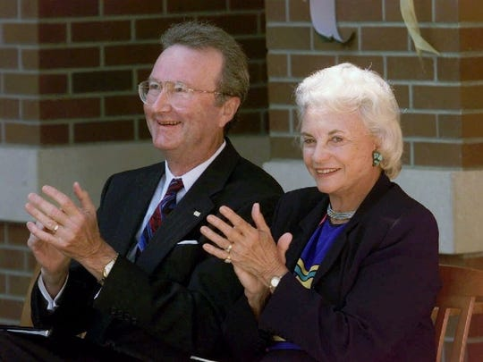 U.S. Supreme Court Justice Sandra Day O'Connor laughs with University of Oregon President Dave Frohnmayer in Eugene, on  Sept. 15, 1999, during the dedication ceremony for the new William W. Knight Law School Building.