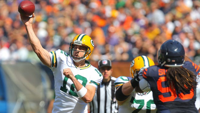 Green Bay Packers quarterback Aaron Rodgers throws a pass during the first quarter against the Chicago Bears at Soldier Field.