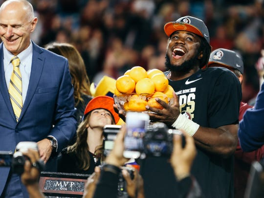 Dalvin Cook is awarded Orange Bowl MVP trophy on Friday, December 30, 2016. The Seminoles topped the Michigan Wolverines 33-32.