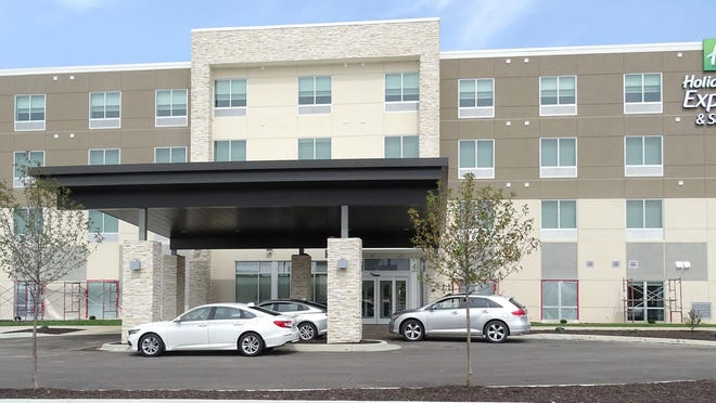 The Holiday Inn Express & Suites is open for business nearly three years after breaking ground. The hotel features 81 rooms, an indoor pool and a meeting room.