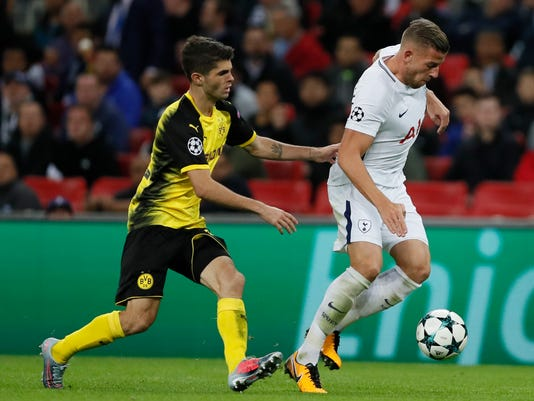 Tottenham's Toby Alderweireld, right, challenges for the ball with Dortmund's Christian Pulisic during the Champions League group H soccer match between Tottenham and Borussia Dortmund, at the Wembley stadium in London, Wednesday, Sept. 13, 2017. (AP Photo/Kirsty Wigglesworth)