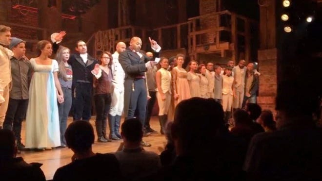 """Brandon Victor Dixon, who plays Arron Burr in """"Hamilton,"""" addresses Vice President-elect Mike Pence from the stage."""
