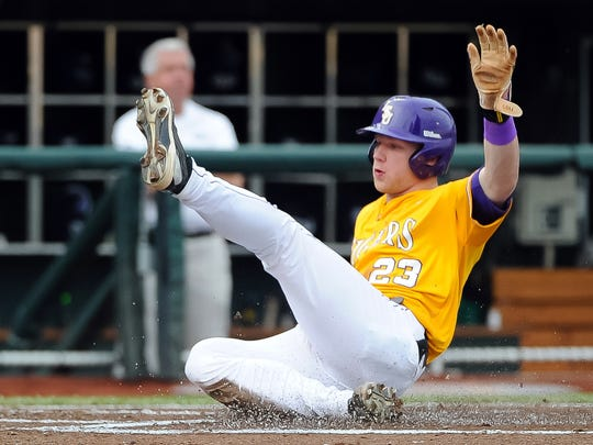 LSU Tigers outfielder Jake Fraley slides in with the first run of the game in the first inning against the TCU Horned Frogs in the 2015 College World Series at TD Ameritrade Park. Fraley was taken in the second round by the Tampa Bay Rays.