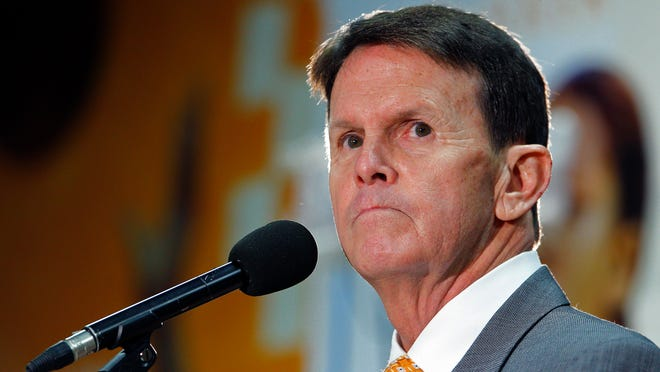 University of Tennessee athletic director Dave Hart pauses as he speaks to reporters about the firing of head basketball coach Donnie Tyndall on Friday.