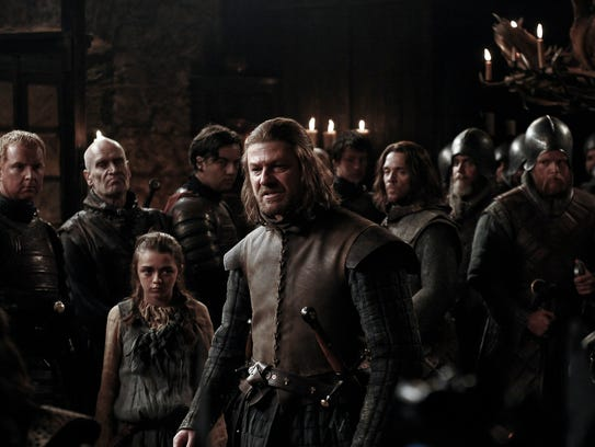 "Little Arya Stark (Maisie Williams) with her doomed father, Ned Stark (Sean Bean) in Season 1 of HBO's ""Game of Thrones."""