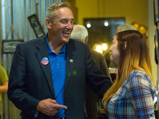 """William """"Bill"""" Soules, democrat running for New Mexico Senator for district 37, speaks with supporter Rhiannon Hardin, 24, of Las Cruces, on Tuesday, November 8, 2016, at Salud in Mesilla, New Mexico."""