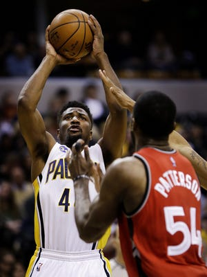 Indiana Pacers forward Solomon Hill (44) goes up for the shot over Toronto Raptors forward Patrick Patterson (54) at Bankers Life Fieldhouse on March 17, 2016.