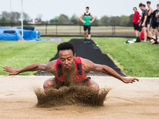 Wapahani's Sofani Buck competes in the long jump during