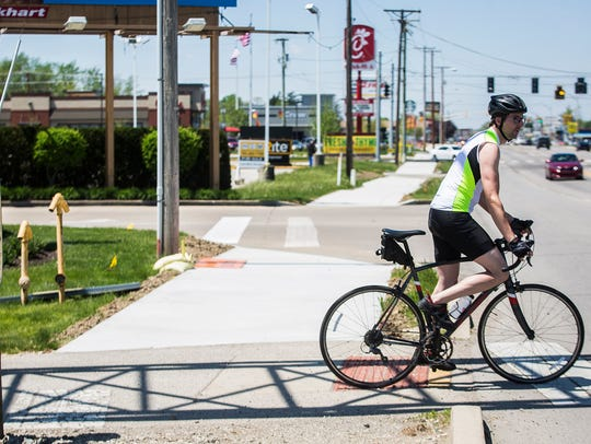 Construction of a bike-friendly sidewalk that extends