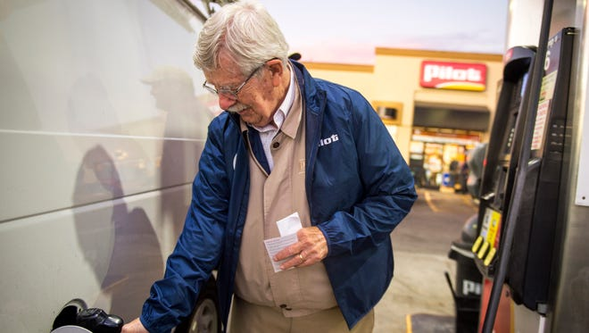 Knoxville News Sentinel editorial cartoonist Charlie Daniel helps pump gas at the Pilot gas station on Western Avenue on Monday, Oct. 2, 2017. Daniel is part of Pilot Celebrity Pumpers, in which Knoxville celebrities help pump gas in support of Pilot's fundraising efforts for United Way.