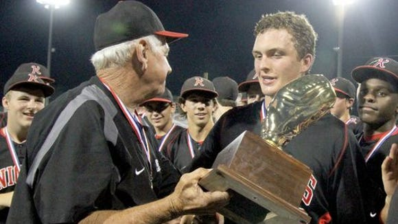 Former West Lauderdale catcher, and Southern Miss signee, Blake Anderson (right) celebrates with head coach Jerry Boatner after winning the Class 4A State Championship last month.