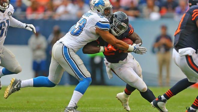 Lions outside linebacker Kyle Van Noy takes down Bears running back Jordan Howard during a game earlier this season.