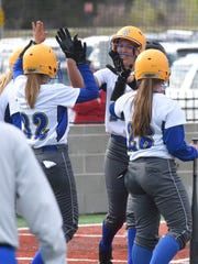 Mountain Home's Maly Tabor is congratulated at home
