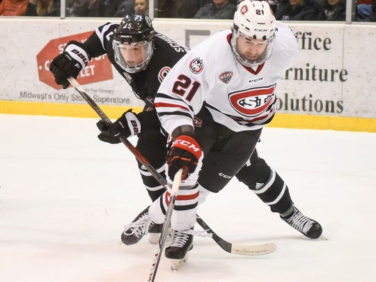 St. Cloud State's Jake Wahlin steals the puck from Nebraska-Omaha's Jalen Schulz during the first period Saturday, Feb. 3, at the Herb Brooks National Hockey Center.