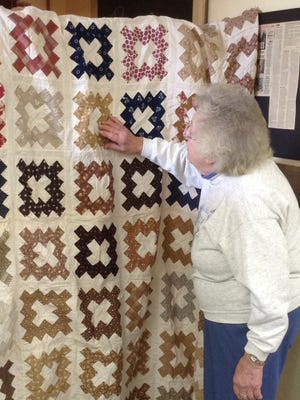 Byron Historical Society member Joyce Kindschuh studies the late 19th century signature quilt that will be on exhibit at the organization's Holidays and Celebrations Open House on Saturday, Dec. 6. The quilt celebrates the spirit of quilting bees. It was recently donated to the Byron Historical Society by a descendant of the Briggs family and Oakfield United Methodist Church. It features the names of 56 young ladies and women from the Byron area.
