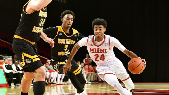 MU's Michael Weathers drives to the hoop against NKU.