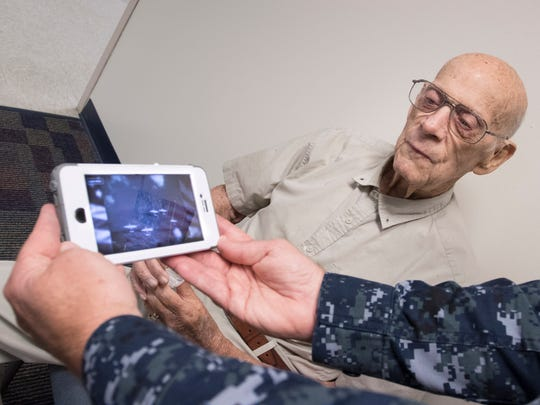 WWII Veteran Paul McClain watches a video with Executive